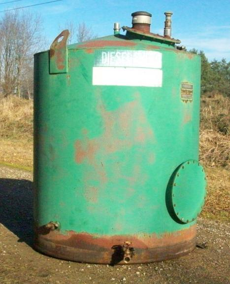"1000-Gallon Above Ground Fuel Storage Tank, Or for Any of Your Chemical or Liquid Storage Needs on the Farm, Has Safety Valve and Gate Valve on Outlet, Also Fitting Cap and Tank Vent, Approximately 5'6"" Diameter x 7' Tall, Good Condition, CN1077"