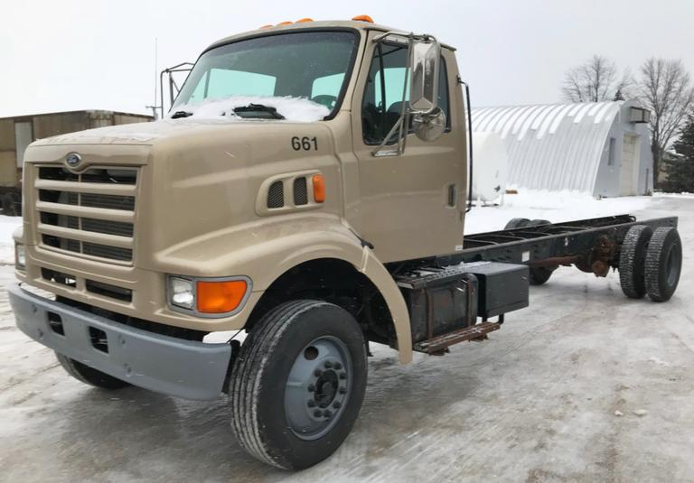 1998 Ford L8501 Truck, (252,000 Miles), 10k lb. Front Axle, 19.5k lb. Rear Axle, 5.9 Cummins Diesel, Allison 4-Speed Auto, Air Ride, Tires are Good, Runs and Drives Well, Clean and Clear Title, CN1143