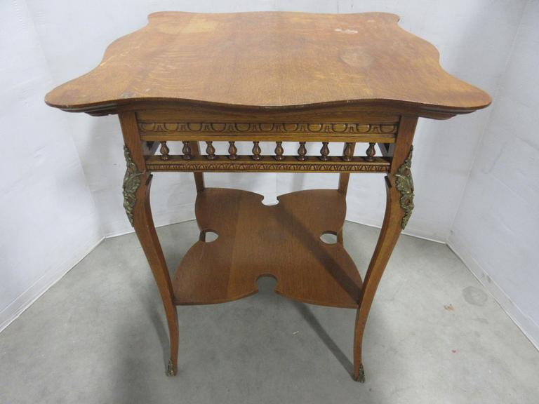 Antique Victorian Table with Curved Metal Accents from the 1800s, Top has Curved Edges