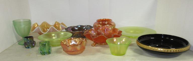 "(12) Pieces of Carnival and Colored Glass by Various Makers, Include: Brockwitz Blue Curved Star 8"" Bowl, Brockwitz Marigold Curved Star Flower Bowl, Dugan Peach Opal Ski Star 10 1/2"" Ruffled Bowl with a Rim Chip, Dugan Green 1 lb. Candy Jar Bottom, St. Clair Green Swan Toothpick Holder, St. Clair Purple Swan Toothpick Holder, Sowerby Marigold Threaded Petals 5 1/2"" Bowl, Vaseline 5"" Mayonnaise, Black 9"" Bowl with Gold Decoration, Vaseline 8"" Rolled Rim Bowl, Vaseline 11 1/2"" Bowl, Marigold W..."