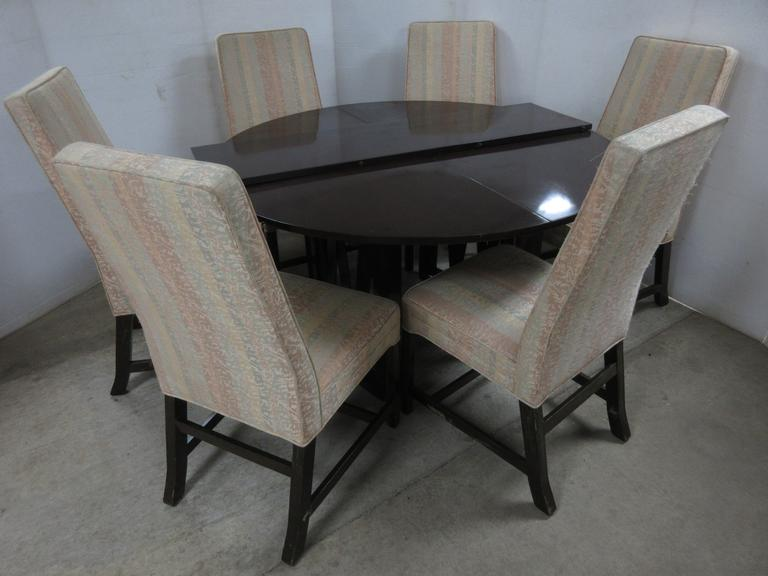 Round Mahogany Color Table with (6) Dining Chairs with a Table Leaf