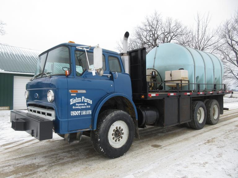 "1985 Ford Stake C-800 Semi Tractor, 3208 Engine, Allison Transmission, Tandem Flatbed, 3035-Gallon Tank, Induction Tank, 3"" Transfer Pump with Electric Start, Electric 50' x 2"" Hose Reel, Recirculate System, Sight Gauge, 35-Gallon Clean Water Tank"