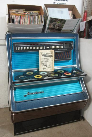 Wurlitzer Jukebox with Manual and (2) Boxes of 45 RPM Records