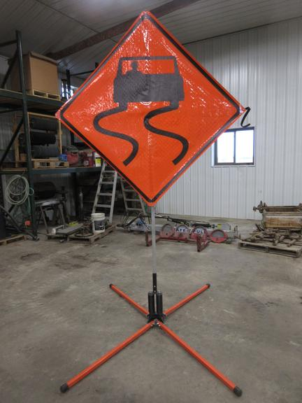 Sign Stand with Caution Sign, Spring Loaded Base, Fold Down Design.  Note:  Same photos are used for Lot #96 and #97.  Pictures are a good representation of both signs - you are bidding on one sign.