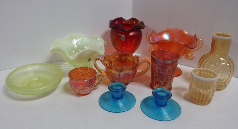 "(10) Pieces of Fenton Carnival Glass, Include: Marigold Diving Dolphins Compote, Amber Opal Tumble-Up, Pair of Blue No. 314 Candlesticks, Vaseline No. 545 5 1/4"" Cupped Bowl, Marigold Orange Tree Breakfast Sugar, Marigold Wreath of Roses/Persian Medallion Punch Cup, Vaseline Opal Diamond Optic Bowl SGS 2003 Souvenir, Red Diamond Optic Vase SGS 2004 Souvenir, and a Marigold Butterfly and Berry Tumbler"