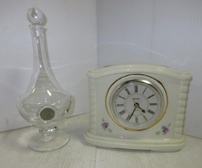 Porcelain Bulova Clock, Includes a New Battery, Like New; Older Bottle with Glass Stopper, Bottle has a Slight Crack in the Neck, Does Not Leak