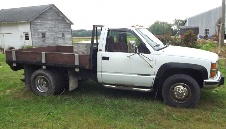 1993 Chevy One-Ton 4x4 Silverado Dually with Flatbed, 6.5L Turbo Diesel with Approx. 15,000 Miles on Rebuild, 5-Speed Manual Shift, A/C, Power Windows and Locks, Bumper and Gooseneck Hitches, Aluminum Storage Box Included, Runs and Drives Well, Clean and Clear Title