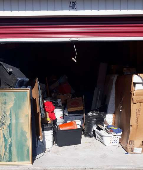 Storage Unit No. 466, Unit Appears to Contain: A Sink, Bathroom Shower Wall, Household Items, and Boxes