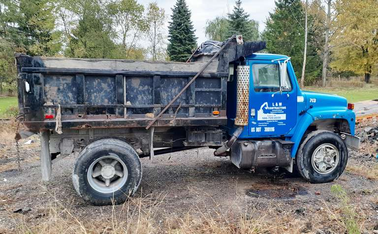 1985 International 5-Yard Dump Truck, Needs a Rear Seal on Transmission, Tires are in Good Condition, Brakes Need Adjusting but Stops, Runs Great, Just Need to Downsize, Clean and Clear Title