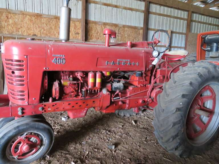 1955 Farmall Diesel 400 Tractor, Four-Cylinder Diesel Engine, Torque Amplifier Partial Power Shift Transmission with 10 Gears, Forward and Reverse, No Battery, Rear Hydraulic Remotes, Hour Meter Reads 0000.08 Hours, Not Running but in Great Condition for a Restoration Project