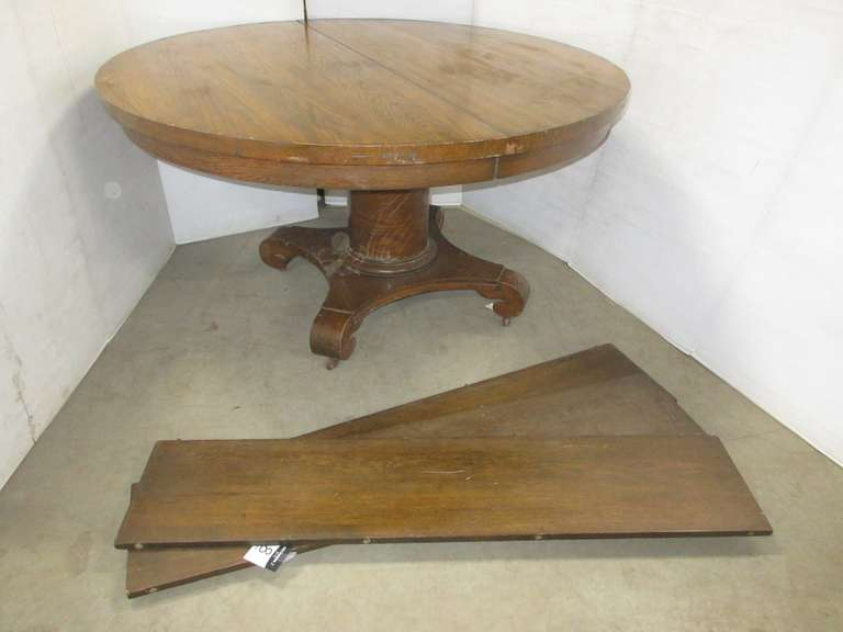 Round Oak Pedestal Table, Medium Finish, Has Three Leaves