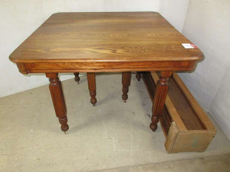Antique Oak Table with (8) Leaves in Carrying Case