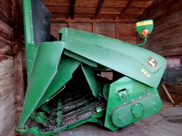 "2005 John Deere 693 Corn Head, 6-30"" Row (Set Up as 28"" Row), Single-Point Hookup, Straight Fluted Rolls, Stubble Lights, Telescoping Shafts, Hydraulic Deck Plates, Header Height Sensors, Contour Master, Needs Nine New Chains"