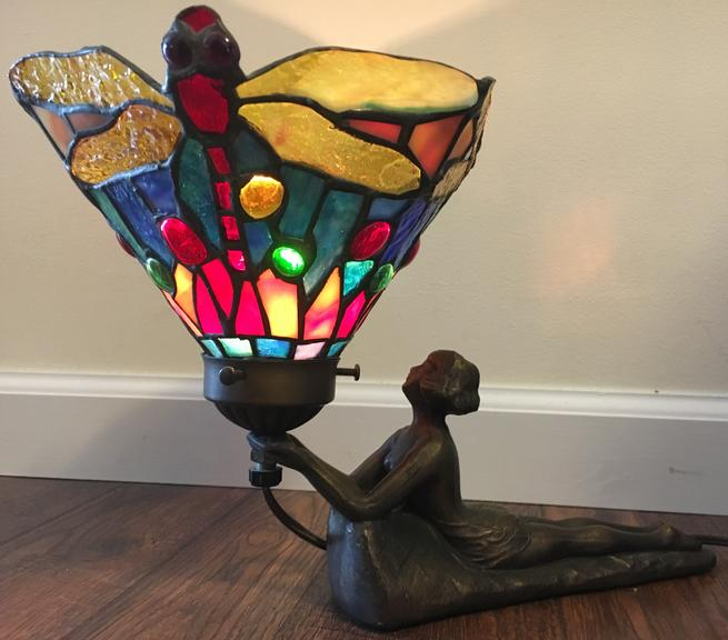 Tiffany-Style Laying Lady Table Lamp, Lamps Base Features a Lady in Heavy Cast Bronze Color Metal Holding a Tiffany-Style Shade with Jewels Nestled on the Edges Throughout