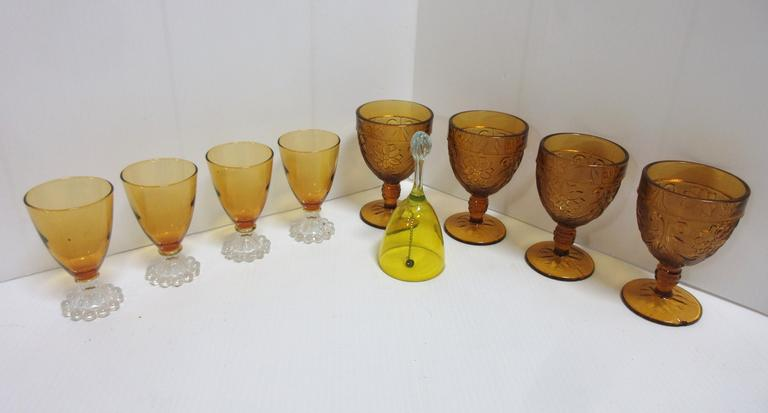 (4) Tiara Goblets, Small Chip Base; (4) Amber Glasses with White Stem; Yellow Bell with a White Handle