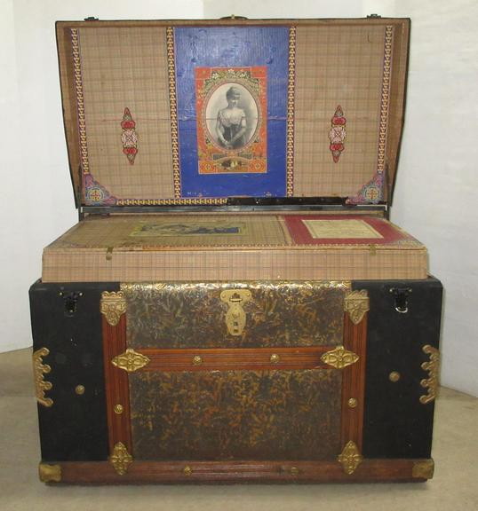 Flat Top Old Trunk on Rollers, Has Liner Shelf with the Lady on Top, Two Compartments in Liner, Fancy Trim, Mfg. Eggelam Drigwid, OH, 1885-189, Gold Trim and Black