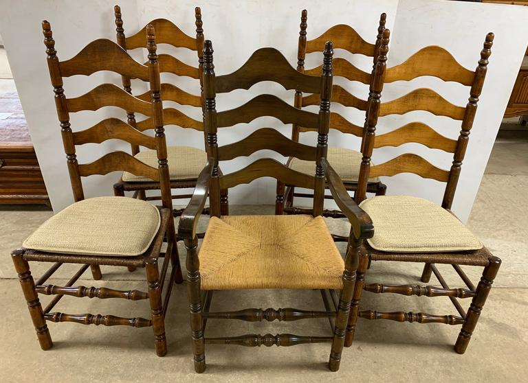 "(4) Ladder Back Chairs with Rush Seats, Seat- 20""W x 17""D x 18 1/2""H, Chair- 45 3/4""H from Floor to Top of Seat;  Arm Chair, Seat- 21""W x 17 1/2""D x 29""H from Floor to Top of Arms; (4) Chair Pads"