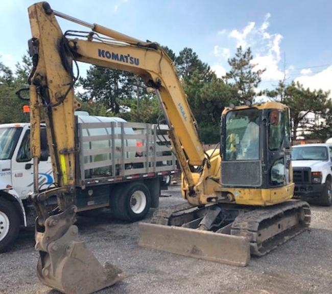 "2011 Komatsu PC-88MR-8 Excavator, S/N: 005585, (5139 Hours), On Rubber Tracks, Plumbed with Auxiliary Hydraulics that Provide Both One-Way and Two-Way Oil, Fully Enclosed Operator's Cab with AC, AM/FM Radio, Dozer Blade, Werk Brau Quick Coupler for Attachments, Komatsu 24"" Heavy Duty Bucket with Teeth, Road Liner Tracks, Work Lights on Top of the Cab and on the Boom, Tracks are Worn, Blade and Quick Coupler are Not Currently Fully Functioning"