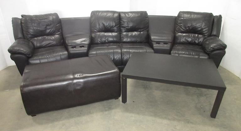 Black Sectional Couch, Black Coffee Table, and an Ottoman
