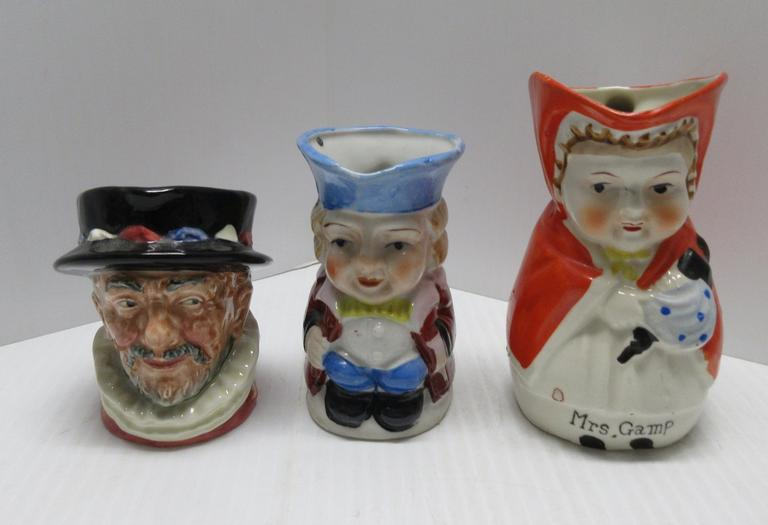 "(3) Toby Mugs: ""Mrs. Gamp"", Charles Dickens Character; Royal Doulton, 1946, Beef Eater; Smaller One from Japan"