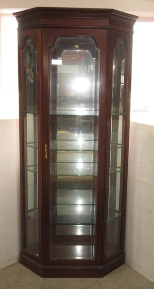 Corner Curio Cabinet by Jasper Cabinet Co., Beveled Exterior Glass, Adjustable Glass Shelving with Plate Rails, Lighting, and Piano Hinged Door