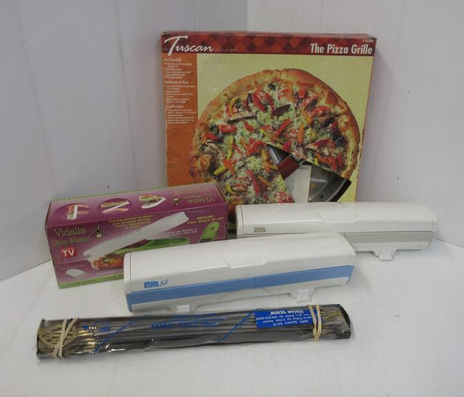 Kitchen Helper Items, Include: Pizza Grille, Nice; Shish Kebab Skewers, New; Chop Wizard, New; Wrapmaster Foil Keeper and Wrapmaster Plastic Wrap