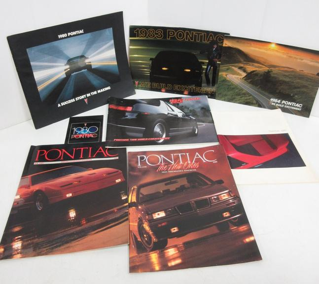 (8) 1980s Pontiac Sales Brochures and Pamphlets, Include: Two- 1980, One- 1983, One- 1984, One- 1985, One- 1986, One- 1988, and One- 1989