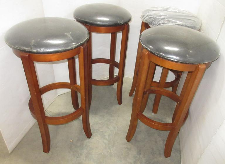 (4) Matching Bar Stools with Black Cushions and Plastic Covers
