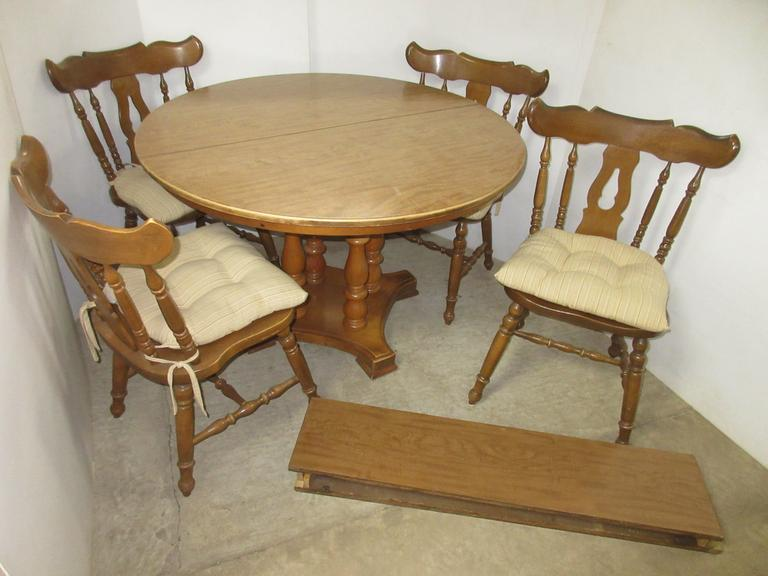 Table with (2) Leaves and (4) Chairs with Cushions