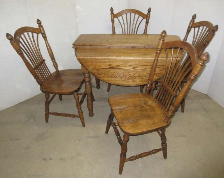 Five-Piece Oak Dining Set with (4) Chairs, Has Drop-Down Sides, and (2) Leaves