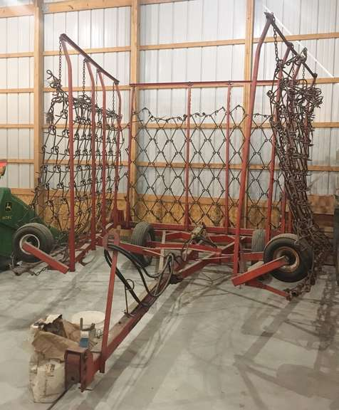 McFarlane 30' Harrow, Front Fold, Hydraulic Lift with Long Hoses, Newer Bed with Minimal Acres, Housed, Good Condition