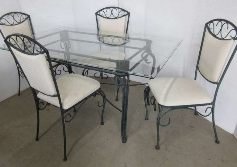 Glass Table with a Wrought Iron Base with (4) Chairs