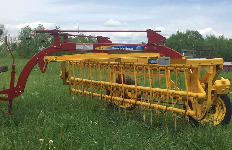 New Holland 258 9' Width Rolabar Hay Rake, Very Little Use, One Owner, Like New Condition