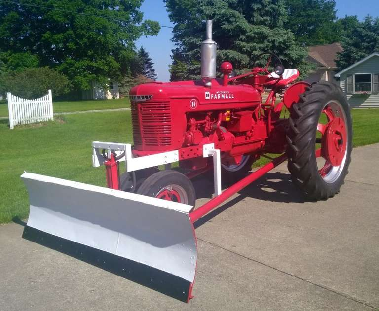 Farmall H Tractor with 7' Blade, Tire Chains, Belt Pulley, 12 V Charging System, 12.4-38 Tires (Weather Checked, but Real Good Tread), Runs Well, Delivery Available for a Fee