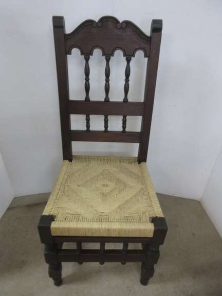 Older Dark Wood Chair with a Wicker Seat