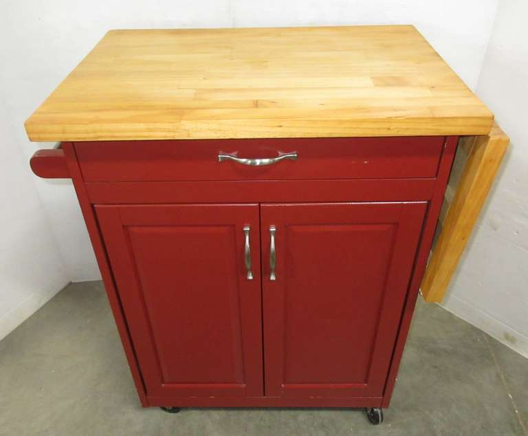 Kitchen Island with Butcher Block Top with Extension on Casters with Breaks, Has a Drawer and Two Doors with Shelf