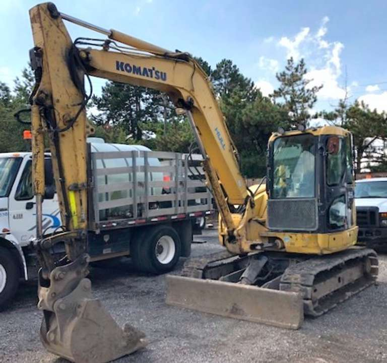 "2011 Komatsu PC-88MR-8 on Rubber Tracks, (5139 Hours), SN: 005585, Plumbed with Aux Hyd that Provide Both One-Way and Two-Way Oil, Fully Enclosed Operator's Cab with A/C, AM/FM Radio, Dozer Blade, Werk Brau Quick Coupler for Attachments, Komatsu 24"" Heavy Duty Bucket with Teeth, Road Liner Tracks, Work Lights on Top of the Cab and on the Boom, Tracks are Worn, Blade and Quick Coupler are Not Currently Fully Functioning"