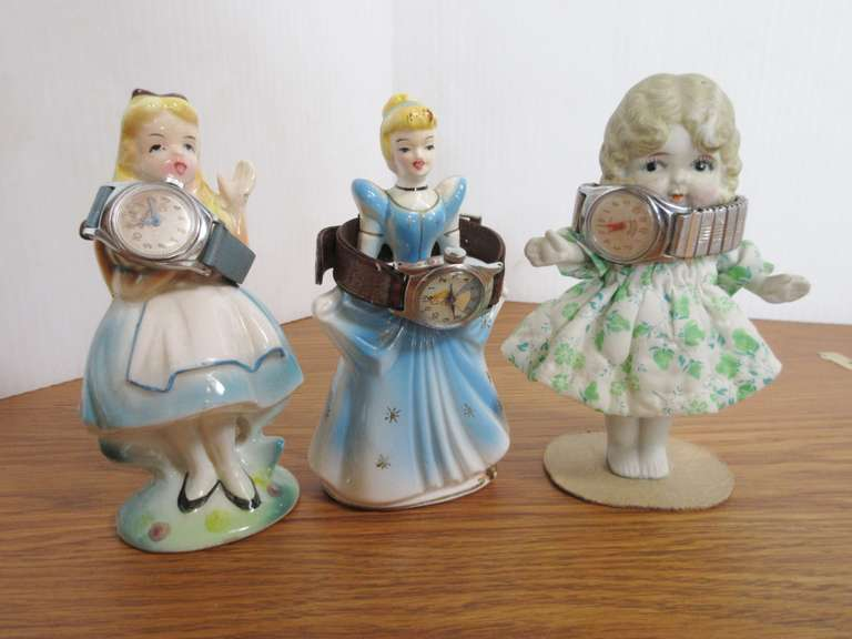 (2) 1960 Disney Cinderella Figurines, Timex Cinderella Watch, Mickey Mouse Watch, and Bisque Doll with Cloth Body