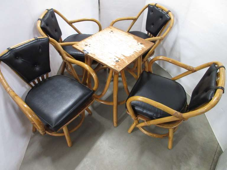 Rattan Table Base with (4) Matching Swivel Chairs, Black Leather Seat and Back Cushions