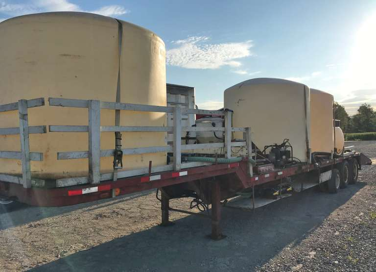 "1966 Hyster Drop-Deck Trailer, VIN:  12508C, 46' Overall - 12' Top Deck, 1' Drop 28' Main Deck, 6.5' Extension in Back, Extension was Designed for Gravity Seed Tender, 225-Gallon Fresh Water Tank with Electric Pump, 3"" Honda Pump with 3"" Fill Hose, One 1800-Gallon Tank with 2"" Valve, Two 2100-Gallon Tanks with 2"" Valves, 65-Gallon Inductor Used for Mixing with 2"" Briggs Pump for Agitation, 15-Gallon Inductor, Tandem Axle 8.25-20 Tube Type Tires, Tag Axle 215/75R17.5, Clean and Clear Title"