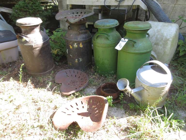 (4) Milk Cans, Watering Can, and (2) Old Tractor Seats