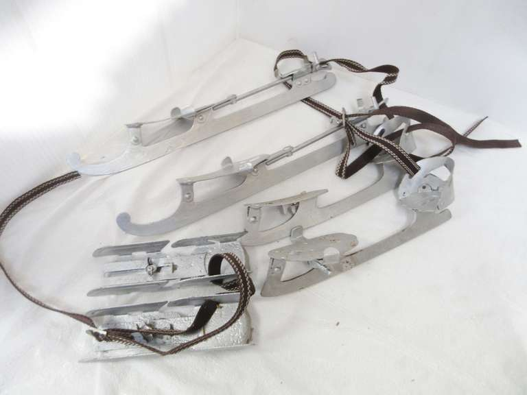 (3) Pairs of Antique Strap on Skates