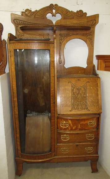 Antique Oak Side-By-Side Secretary, Has Adjustable Shelves and Extra Shelves, and Bow Front Glass Door, Very Ornate Wood Carving on Wheel