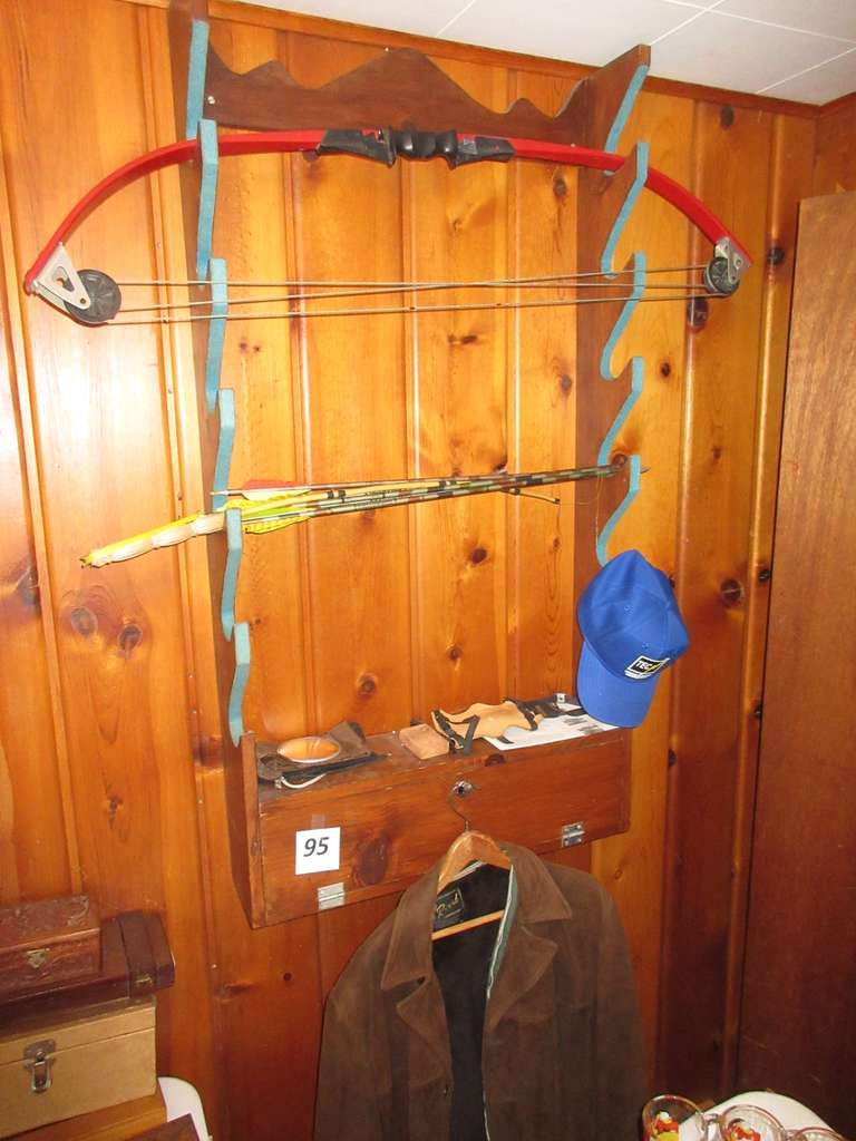 Gun Rack with Child's Compound Bow, Arrows, and Old Reed Sportswear Suede Jacket