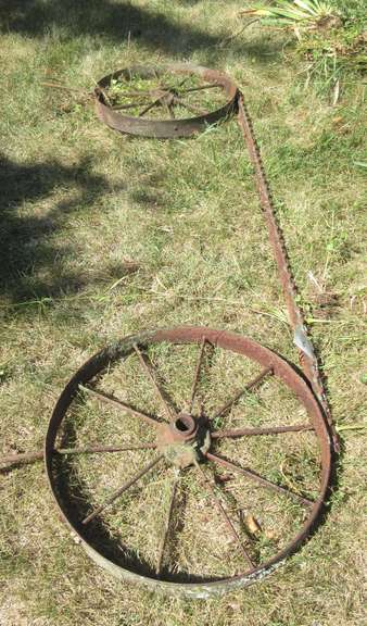 "Handmade Iron Wheel Yard Display, 2'Dia Wheels x 89""L"