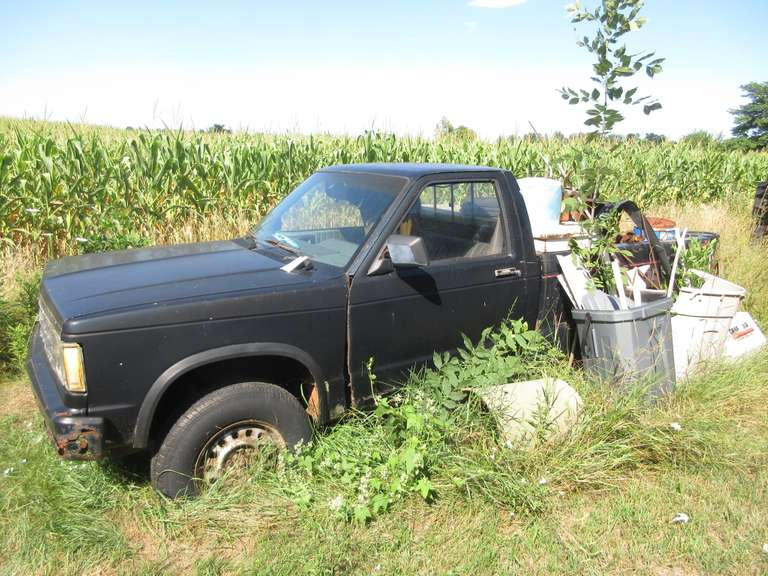 Old Black Chevy S10 Truck, For Parts, No Title, and Large Scrap Pile