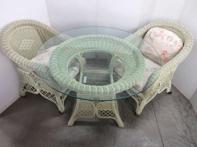Light Green Three-Piece Wicker Patio Set with Heavy Glass Table Top and Chairs on Wheels