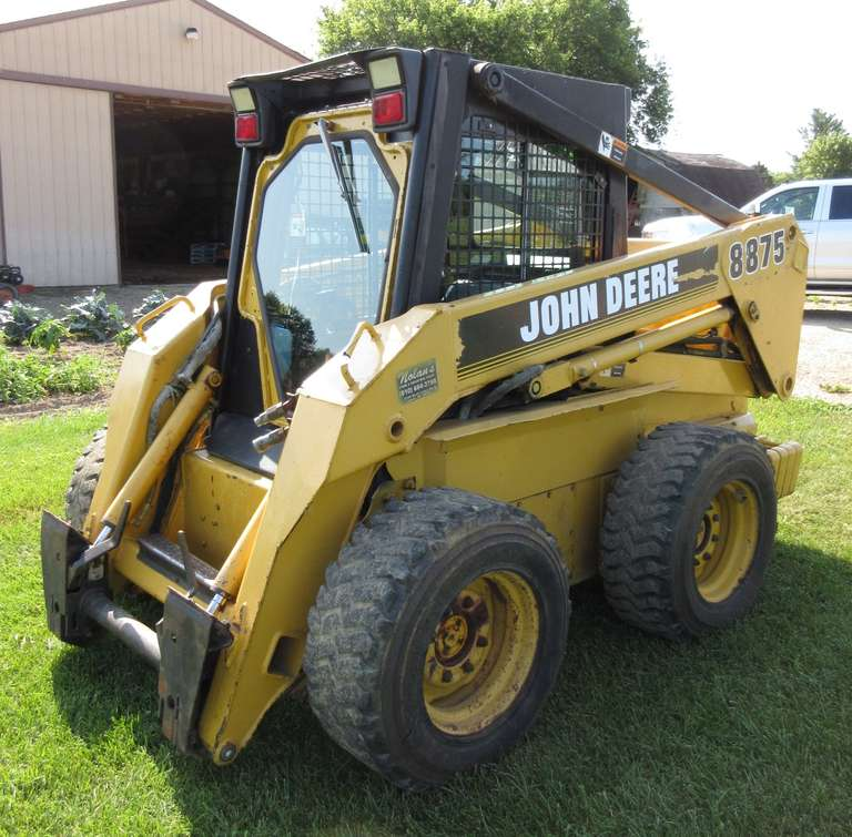 John Deere 8875 Skidsteer, 3-Cylinder Diesel Engine (Like New), Two-Speed Transmission, Winter Coolant Engine Heater, Glass Front Door with Wiper, Glass Windows, Heater and Fan, New Seat, Dome Lights, Removable Rear Weights on Both Sides, Loaded Tires, and Front Remotes, Excellent Condition