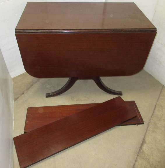 Table with (2) Leaves, Drop Leaf Style with Claw Design Feet