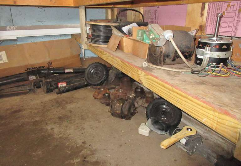 All Contents Under Bench, Includes: Electric Motors, Wheels, Hubs, PTO Shafts, Springs, and More